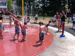 Children play at Chapman Spray park.