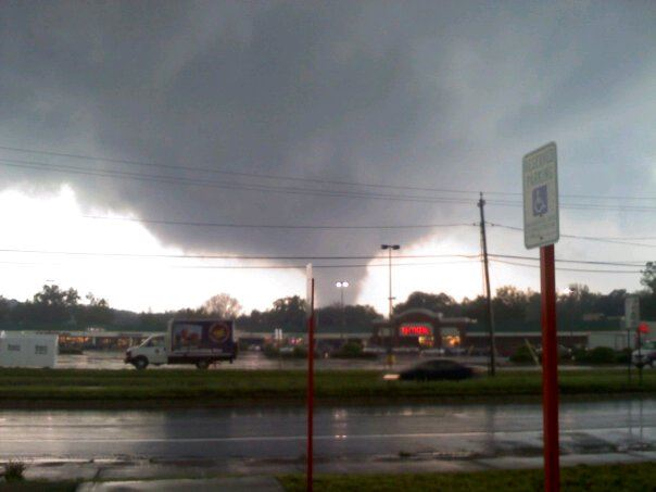 Tornado behind a shopping center
